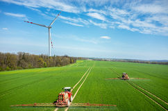 Aerial view of the windmill and the tractors Stock Images