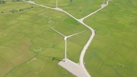 Aerial view windmill turbine on green field background. Wind power turbine generation on energy station drone view from. Above. Alternative energy sources stock footage