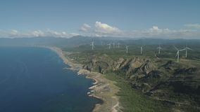 Solar Farm with Windmills. Philippines, Luzon. Aerial view of Windmills for electric power production on the coast. Bangui Windmills in Ilocos Norte, Philippines stock video