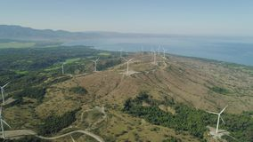 Solar Farm with Windmills. Philippines, Luzon. Aerial view of Windmills for electric power production on the seashore. Bangui Windmills in Ilocos Norte stock video