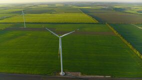Aerial view of windmills farm generating power. Wind turbines producing energy.