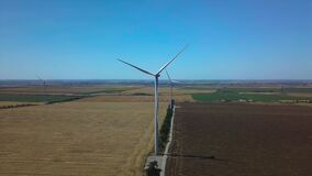 Aerial view of windmills rotating by the force of the wind and generating renewable energy. 4K