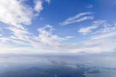 Aerial view from window air plane and top views of Phang Nga Bay. And blue sky and cloud, phuket island before landing at Phuket, thailand royalty free stock images