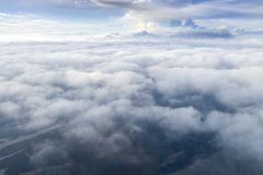 Aerial view from window air plane and top views of Phang Nga Bay. And blue sky and the sea of clouds, phuket island before landing at Phuket, thailand royalty free stock images