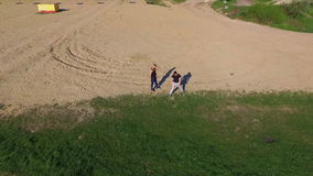 Aerial view of Wing Chun  on a sand between two strong men stock footage