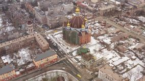 Aerial view of the winter city. Mariupol Ukraine. Aerial view of the winter city. You can see the city square, a large Orthodox church. Mariupol Ukraine stock footage