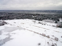 Aerial view of winter forest from drone. Aerial view of winter forest covered in snow. drone photography Stock Photography