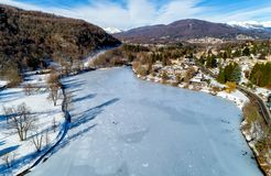 Aerial view of winter landscape of frozen lake Ghirla in province of Varese. royalty free stock photography