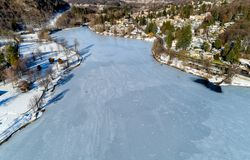 Aerial view of winter landscape of frozen lake Ghirla in province of Varese. stock image