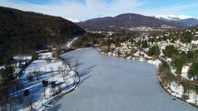 Aerial view of winter landscape of frozen lake Ghirla in province of Varese. stock video footage