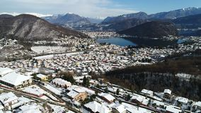 Aerial view of winter landscape of lake Ceresio, Swiss Alps and village Cadegliano Viconago in province of Varese. stock video footage