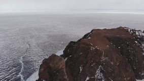 Aerial view of winter landscape of rocky mountains on lake Baikal. stock video footage