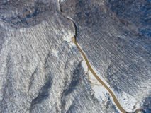 Aerial view of winter mountain road. Royalty Free Stock Photography