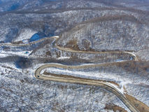 Aerial view of winter mountain road. Royalty Free Stock Images