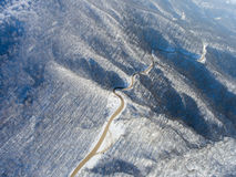 Aerial view of winter mountain road. Stock Photo