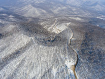 Aerial view of winter mountain road. Stock Photos