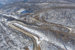 Aerial view of winter mountain road. Royalty Free Stock Photos