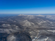 Aerial view of winter mountain road in the woods. Stock Photo