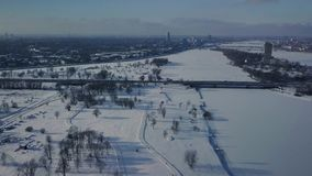 Aerial view on winter park with cross country skiing slope. Aerial view on winter park with cross country skiing slope and people skiing on it. Top view from stock video