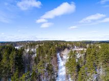 Aerial view of a winter road. Winter landscape countryside. Aerial photography of snow forest. Captured from above with a drone. A Stock Photography