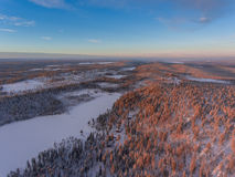 Aerial view of winter snowscape and forest Royalty Free Stock Photos