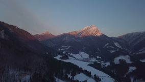 Aerial view of winter sunset over alpine mountains stock video footage