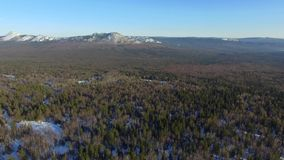 Aerial view of winter Taganay Mountains ridge stock video footage