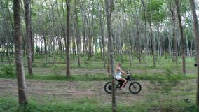 Aerial view of woman on electric bicycle in the forest