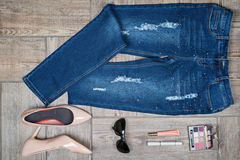 Aerial  view of woman's jeans and accessories Royalty Free Stock Image