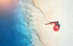 Aerial view of woman with swim ring on the sandy beach royalty free stock photo