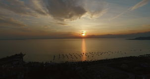 Aerial view on wonderful panoramic view on sunset over beautiful lake Garda (Lago di Garda) with mountains, yachts and stock video