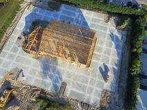 Aerial wooden house commercial building construction. Aerial view wood frame house under construction with foundation in Humble, Texas, USA. New stick built royalty free stock photography