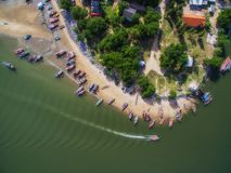Aerial view of boats and fishing village in Pranburi, Thailand. Aerial view of wooden boats and fishing village in Pranburi, Thailand Stock Image
