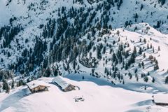 Aerial view of wooden houses in beautiful snow-covered mountains, mayrhofen ski area, austria. MAYRHOFEN, AUSTRIA - FEBRUARY 19, 2018: aerial view of wooden royalty free stock photos