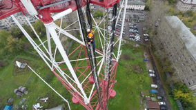 Aerial view. workers climb the TV tower stock video