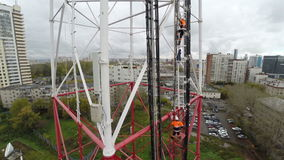Aerial view. workers climb the TV tower stock footage