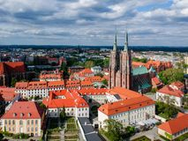 The aerial view of Wroclaw: Ostrow Tumski, Cathedral of St. John the Baptist and Collegiate Church of the Holy Cross and St. Barth. Olomew royalty free stock images