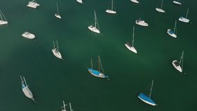 Aerial view of yacht cub and marina on sunny day. Yacht and sailboat is moored at the quay. Fly over stock video