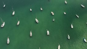 Aerial view of yacht cub and marina on sunny day. Yacht and sailboat is moored at the quay. 4K stock footage