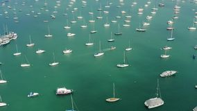 Aerial view of yacht cub and marina on sunny day. Yacht and sailboat is moored at the quay. Fly over stock video footage