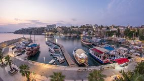 Aerial view of yacht harbor and red house roofs in `Old town` day to night timelapse Antalya, Turkey. Aerial view of yacht harbor and red house roofs in Old stock video footage