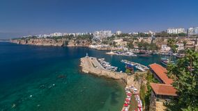 Aerial view of yacht harbor and red house roofs in `Old town` timelapse Antalya, Turkey. Aerial view of yacht harbor and red house roofs in Old town timelapse stock video footage