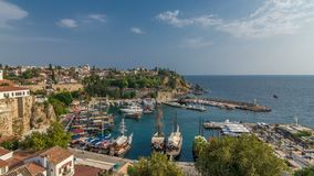 Aerial view of yacht harbor and red house roofs in `Old town` timelapse Antalya, Turkey. Aerial view of yacht harbor and red house roofs in Old town timelapse stock footage