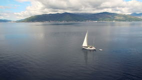 Aerial view of yacht in the sea. This shot was made in Montenegro stock footage