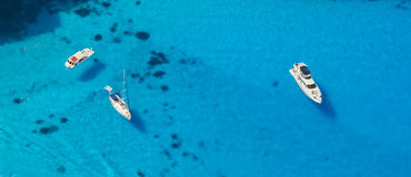 Aerial view of yachts in azure sea Stock Images
