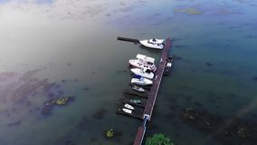 Aerial view of yachts and boats. Is moored at the quay stock video footage