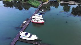 Aerial view of yachts and boats. Is moored at the quay stock footage