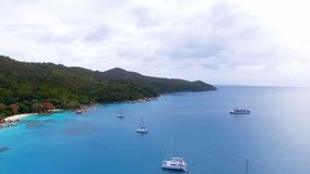 Aerial View Of Yachts In The Indian Ocean 3, Seychelles. Drone Shot Of Yachts In The Indian Ocean, Anse Lazio,Praslin Island, Seychelles stock footage