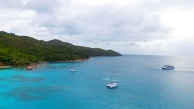 Aerial View Of Yachts In The Indian Ocean 1, Seychelles. Drone Shot Of Yachts In The Indian Ocean, Anse Lazio,Praslin Island, Seychelles stock video footage