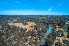 View of Yarra River flowing through suburb in Melbourne. Aerial view of Yarra River flowing through Eltham suburb in Melbourne, Australia royalty free stock photos